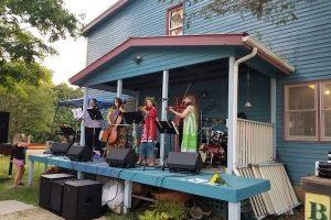 string ensemble on a porch outdoors