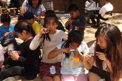 Children playing harmonicas