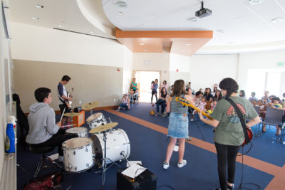 School of Rock band playing for audience at library