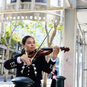 Female Mariachi violin player in downtown San Jose