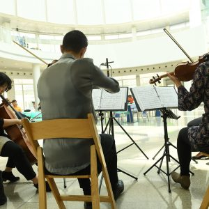 Chamber orchestra quartet performing in the rotunda at San Jose City Hall