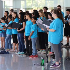 Youth Chorus performing in lobby of the San Jose Main Library.