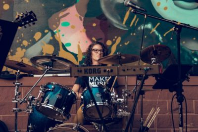 Amanda Roy playing the drums.