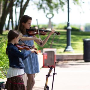 The Carroll Sisters play their violins.