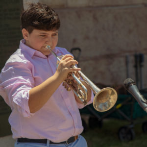 Young man playing his trumpet.