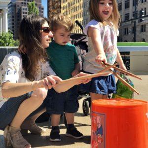 Mom and kids enjoying bucket drumming.